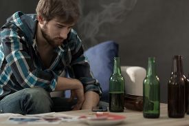 image of alcoholic drinks  - Picture of young alcoholic drinking beers alone - JPG