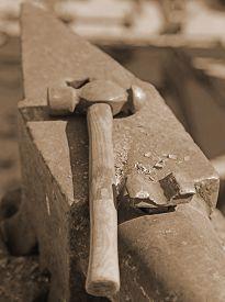 foto of blacksmith shop  - heavy ANVIL and sturdy HAMMER in the blacksmith - JPG