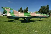 image of super-sonic  - Supersonic Soviet fighter plane Mig 21 on a field - JPG