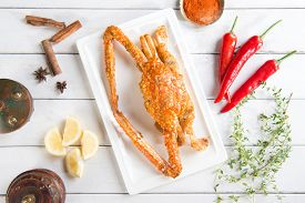 image of cooked crab  - Top view cooked delicious hot and spicy sauce blue crab and ingredients - JPG