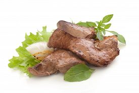 picture of liver fry  - Fried pieces of beef liver with fresh green lettuce basil and fried onion on the white plate - JPG