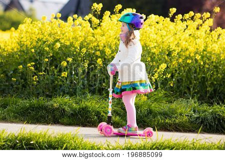 Child Riding Schooter On Way