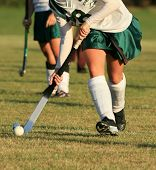 Field hockey player with ball