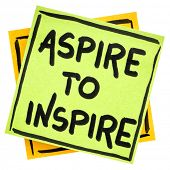 aspire to inspire reminder  - handwriting in black ink on an isolated sticky note poster