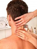 Постер, плакат: Shoulder and neck massage for man in spa salon Doctor making neck therapy in rehabilitation center