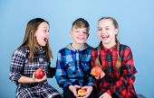 Health Is Our Friend. Cute Little Children Holding Red Apples. Natural Food Is Good For Childrens He poster