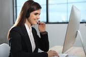 Technical Support Operator With Headset In Modern Office poster