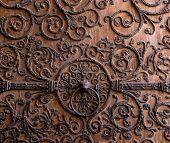 Door detail of Notre Dame de Paris Cathedral, Paris, France. Old wooden door with a metallic pattern poster