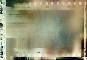 Film negative frames background. Copy space poster