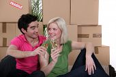 foto of concubine  - Couple having a celebratory drink on moving day - JPG