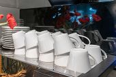 Stacks Of Upside Down Coffee Cups Prepared On Machine. poster