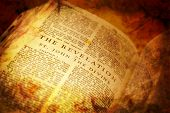 stock photo of revelation  - Bible showing The Revelation in distressed vintage style - JPG