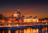 Fantastic Colorful Sunset In Dresden With Dramatic Sky, Over The Elbe River. Old Town Glowing In Lig poster