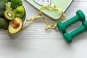 Diet And Healthy Life Loss Weight Concept. Green Apple And Weight Scale Measure Tap With Fresh Veget poster