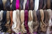 Different Color Human Hair Extensions In Wig Shop poster