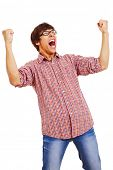 Happy young man wearing checked shirt and jeans in winning pose isolated on white background. Mask i