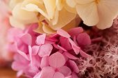 Close Up Of Yellow Pink Bouquet Made Of Hydrangea Decorated With Pink Dried Coral Flowers. Close Up  poster