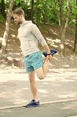 Athlete Always Stretching After Workout. Sportsman Prepare Muscles Outdoor Training. Man Runner Conf poster