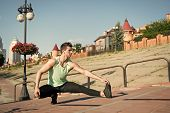 Find Balance. Man Workout Outdoors Urban Background. You Should Stretch Muscles After Workout To Ach poster