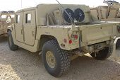 foto of humvee  - hummer parked in the dirt - JPG