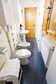 picture of shower-cubicle  - interior of narrow toilet room in old italian apartment - JPG
