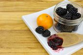 picture of clementine-orange  - Blackberries in a jar - JPG