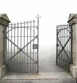 stock photo of wrought iron  - entrance of a graveyard with a open wrought - JPG