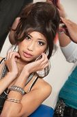 picture of gullible  - Attractive Asian female in tangle of hair at beauty salon - JPG