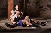 picture of choke  - Mixed martial artist with opponent in submission choke hold - JPG
