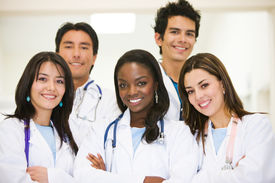 pic of medical assistant  - group of doctors standing and smiling in a hospital - JPG