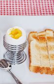 Closeup Soft Boiled Egg With Sliced Toast poster