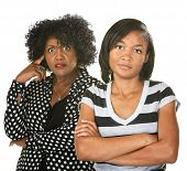 image of disrespect  - Black mother with teenage daughter on isolated background - JPG