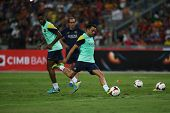KUALA LUMPUR - AUGUST 9: FC Barcelona's Xavi Hernandez kicks the ball during training at the Bukit J