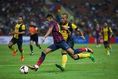 KUALA LUMPUR - AUGUST 10: FC Barcelona 's Neymar Jr. kicks the ball in a friendly game against Malay