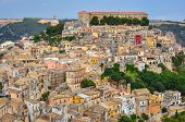 pic of petrified  - Colorful houses in old medieval village Ragusa in Sicily Italy - JPG