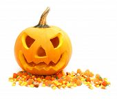 stock photo of jack-o-lantern  - Jack o Lantern with scattered Halloween candy over white - JPG