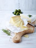 Pecorino and brie cheese on a kitchen board