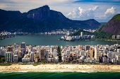 image of ipanema  - Aerial view of buildings on the beach front with a mountain range in the background Ipanema Beach Rio De Janeiro Brazil - JPG