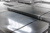 foto of tin man  - Sheet Tin Metal In Production Hall abstract technology concept - JPG