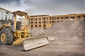 image of bulldozers  - Industrial bulldozer on construction site with space for text - JPG