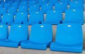 picture of grandstand  - Blue and Empty Seats of a Grandstand - JPG