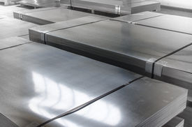 stock photo of tin man  - Sheet Tin Metal In Production Hall abstract technology concept - JPG