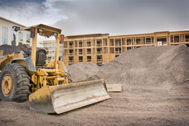 stock photo of power-shovel  - Industrial bulldozer on construction site with space for text - JPG