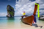 Traditional long tail boat in a clear water of Andaman sea, Thailand