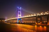 stock photo of hong kong bridge  - Suspension bridge in Hong Kong at night - JPG