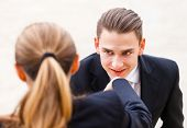 stock photo of polite  - Young businessman greet polite his partner with kissing hand - JPG