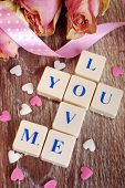 picture of scrabble  - love words made of scrabble lettersdried roses and little heart shapes for valentine on wooden table - JPG