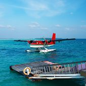 Red seaplane at Maldives