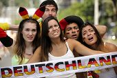 Group of astonished German sport soccer fans.