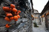 stock photo of hustle  - There is a small village deep in the Taihang Mountains in Shanxi Yue Zhai Feng quaint stone village where the road into town a stone house only the elderly and young children there is no hustle and bustle of the city but there are some fun